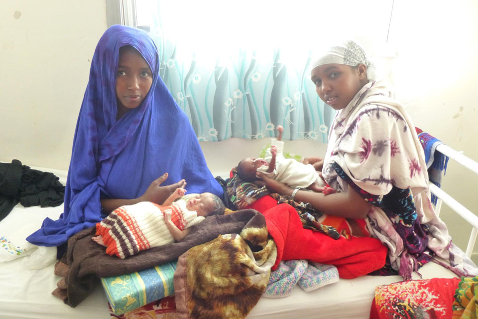 Young mothers bonding with their premature babies.
